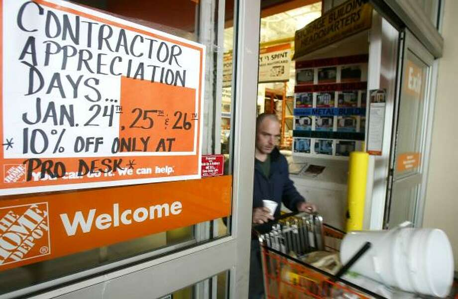 A customer passes a promotional sign at a Home Depot store in Columbus, Ohio. A cooling in the housing boom has hurt retailers who sell merchandise for the home. Photo: JAY LaPRETE, BLOOMBERG NEWS