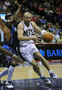 Jason Kidd, right, appeared to be headed to Dallas before the deal reached a snag involving Devean George, who was supposed to head East. Photo: Bill Kostroun, AP