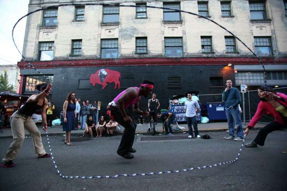 "Richard ""Flat top"" Grayson, center, jumps rope during day one of the Capitol Hill Block Party on Friday, July 22, 2011 in Seattle. Photo: JOSHUA TRUJILLO / SEATTLEPI.COM"