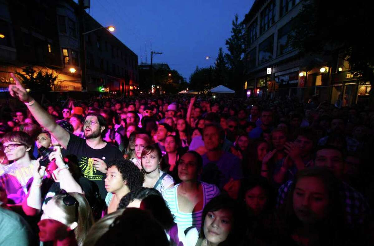 Concertgoers listen to The Head and the Heart during day one of the Capitol Hill Block Party on Friday, July 22, 2011 in Seattle.