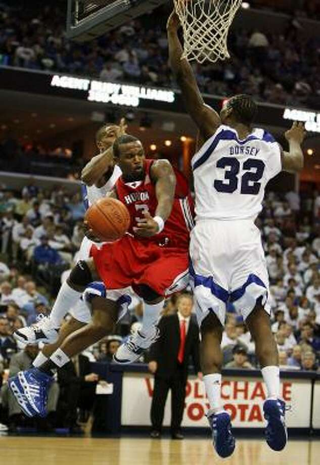 Houston's Robert McKiver looks to make the pass while driving to the basket in a loss at Memphis. Photo: Lance Murphey, AP