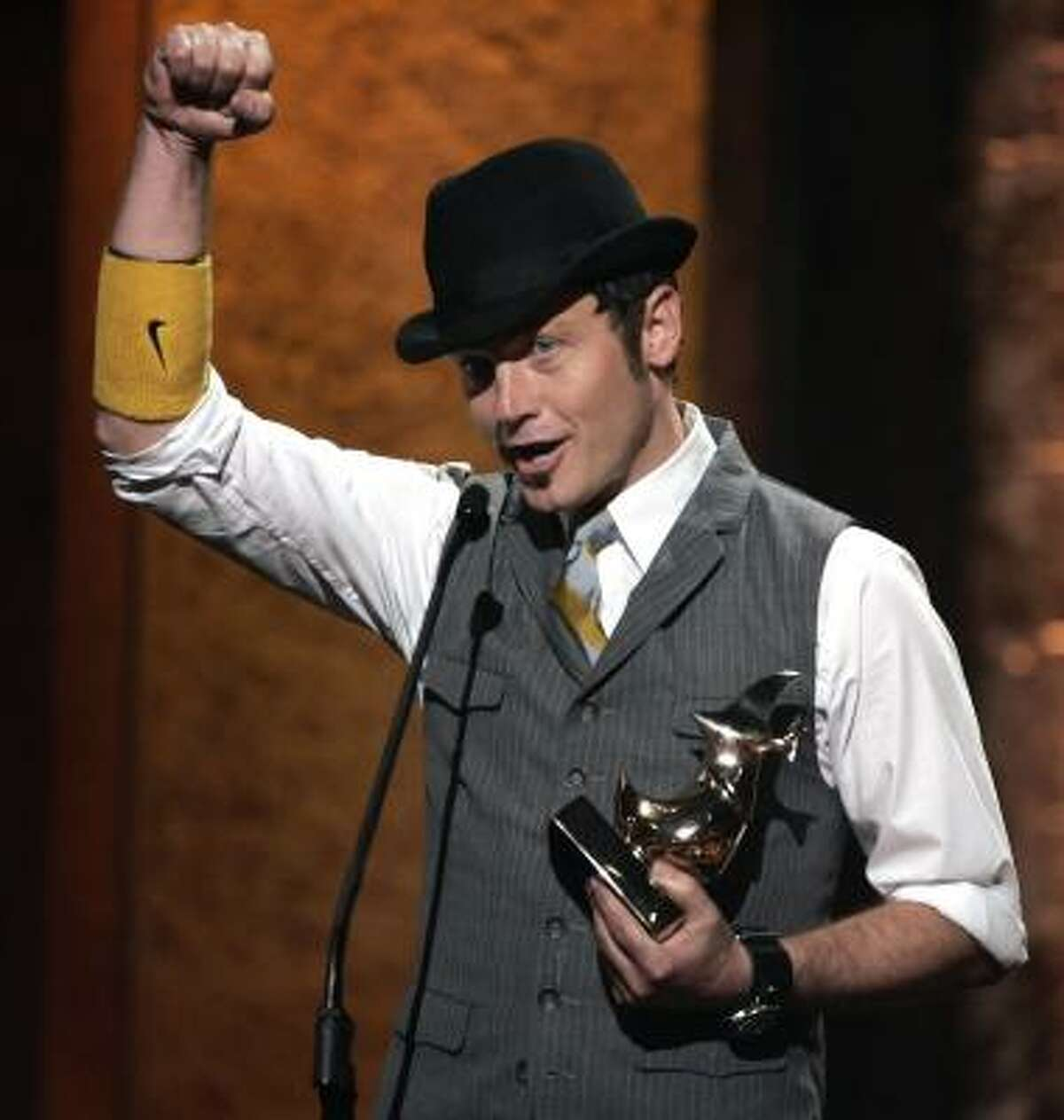Toby Mac accepts the award for artist of the year at the Dove Awards show in Nashville, Tenn., Wednesday.