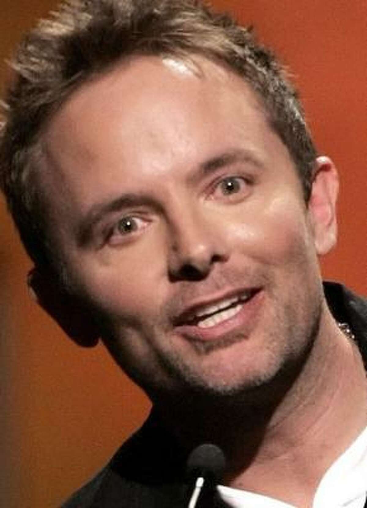 Chris Tomlin accepts the award for male vocalist of the year at the Dove Awards show.