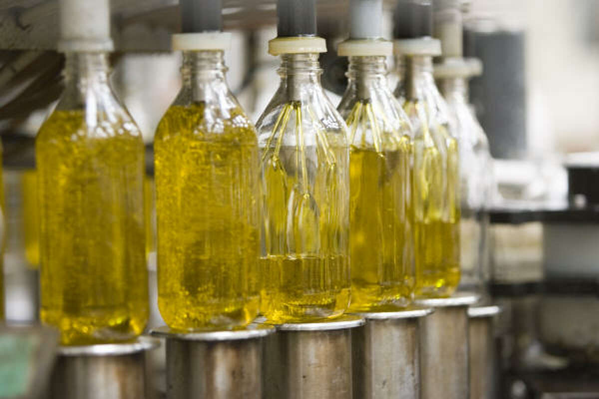Olive oil bottles are filled at the Carbonell olive oil plant on May 20 in Cordoba, Spain.