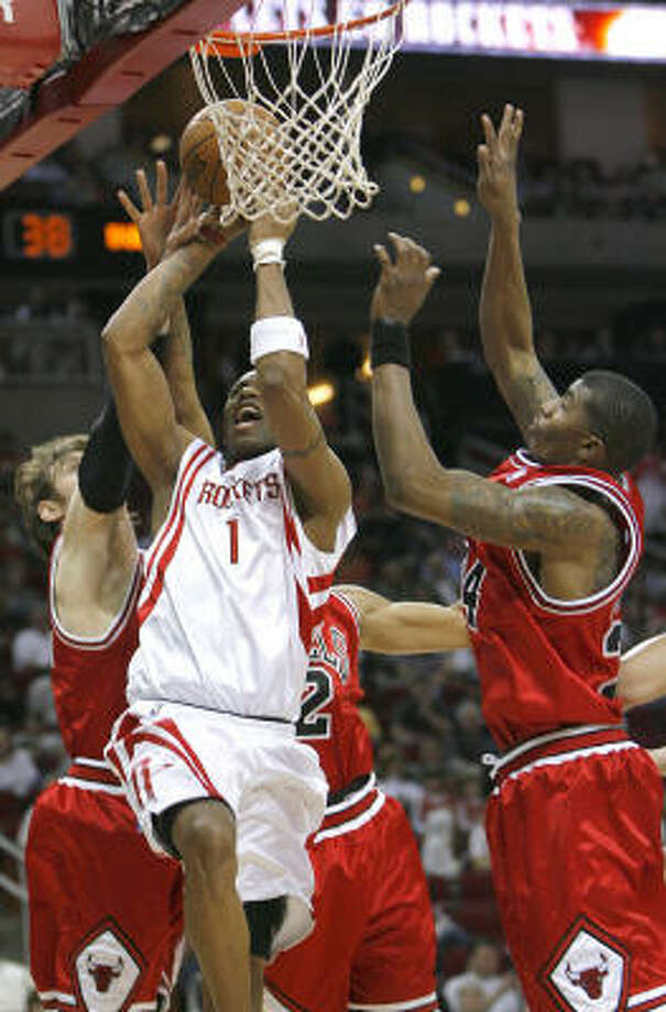 Tracy McGrady is fouled on a drive. He finished with 24 points and eight assists. Photo: Steve Campbell, Chronicle