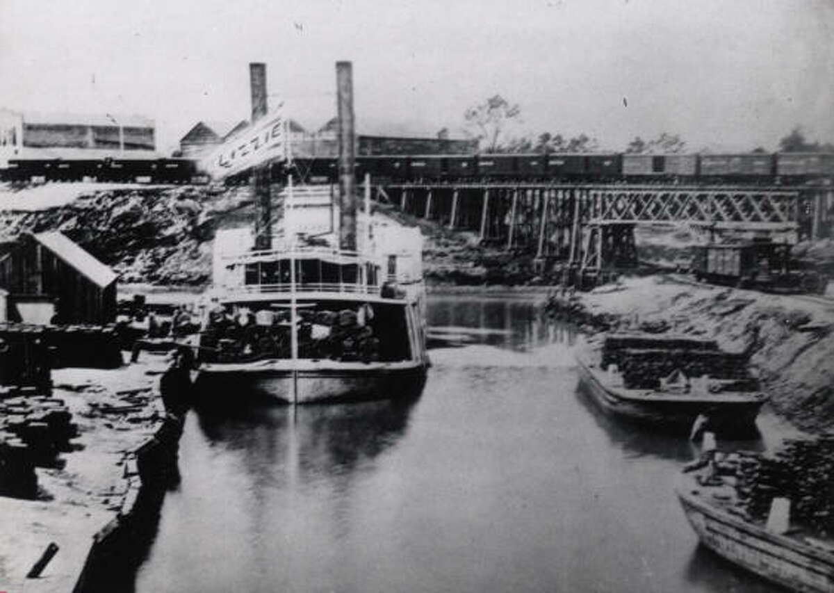 For roughly 75 years, barges navigating Buffalo Bayou carried coffee, cotton and other goods right to ``the port'' at the foot of Main Street, the city's commercial hub.