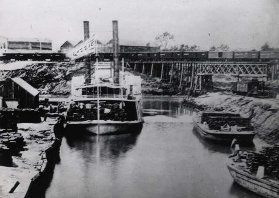 For roughly 75 years, barges navigating Buffalo Bayou carried coffee, cotton and other goods right to ``the port'' at the foot of Main Street, the city's commercial hub. Photo: CHRONICLE FILE