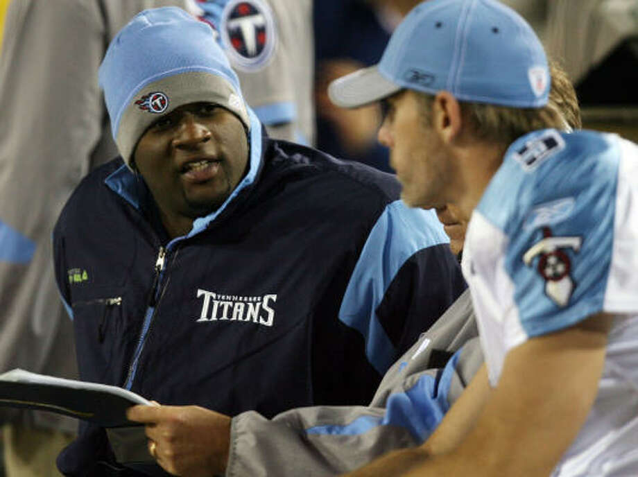 Titans head coach Jeff Fisher says quarterback Vince Young, left, will have to earn his way back onto the playing field. Photo: Doug Benc, Getty Images