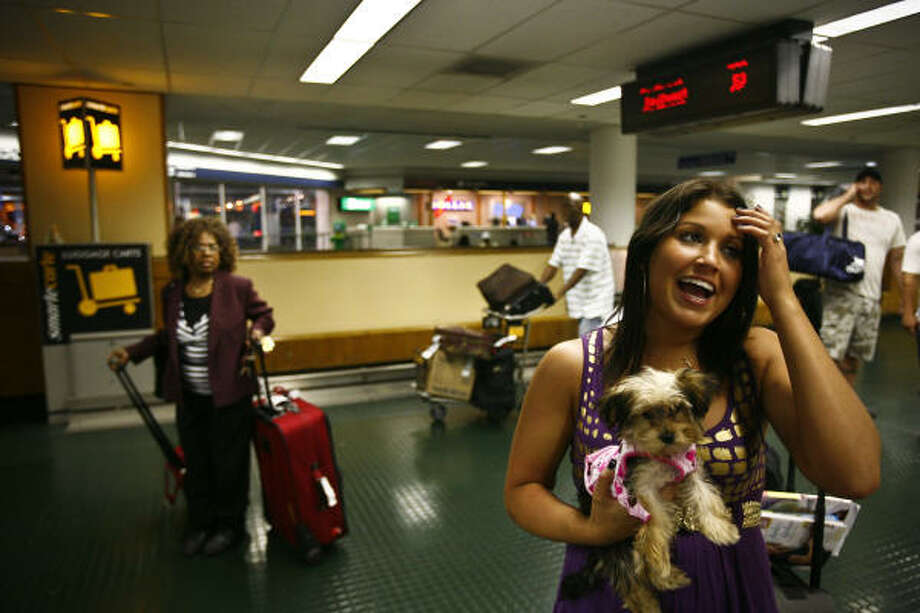 Christine Bordenave is relieved she and her puppy, Nola, survived the ordeal at Hobby Airport on Tuesday. Photo: Michael Paulsen, Chronicle