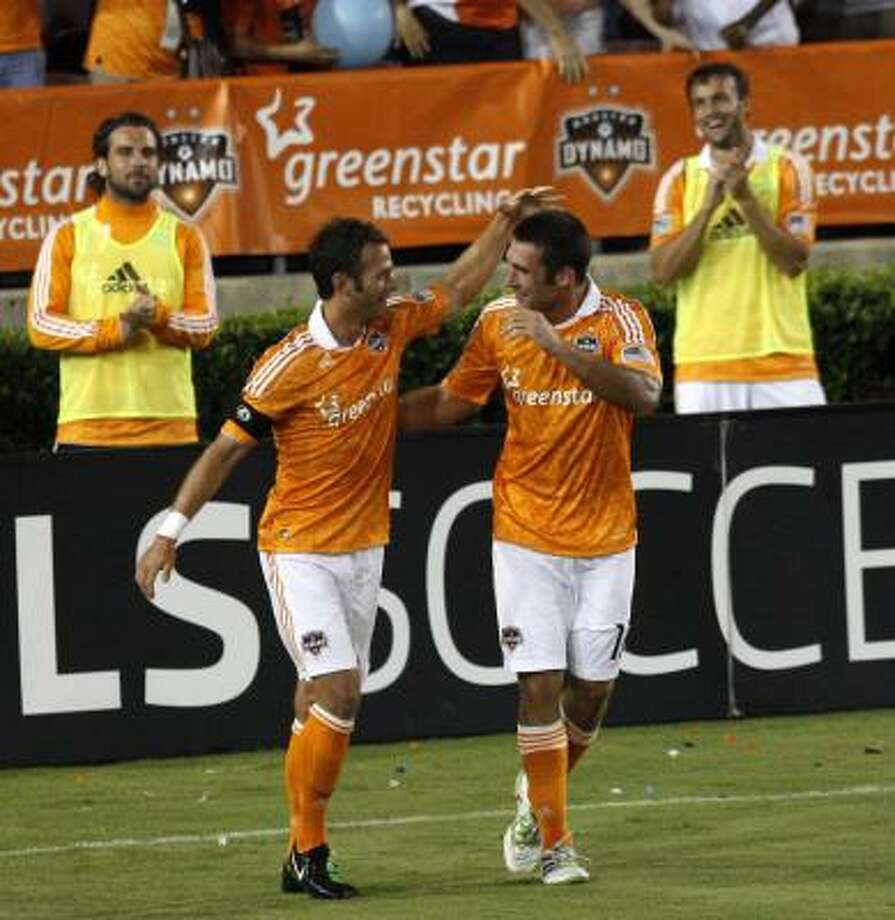 Will Bruin, right, of the Houston Dynamo is congratulated by Brad Davis after scoring his third goal of the game against D.C. United at Robertson Stadium on April 29. Photo: Bob Levey, Getty