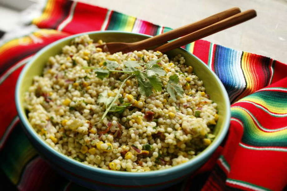 COUSCOUS WITH A KICK: Hatch chiles give couscous a lively flavor boost. Photo: Kevin Fujii, Chronicle