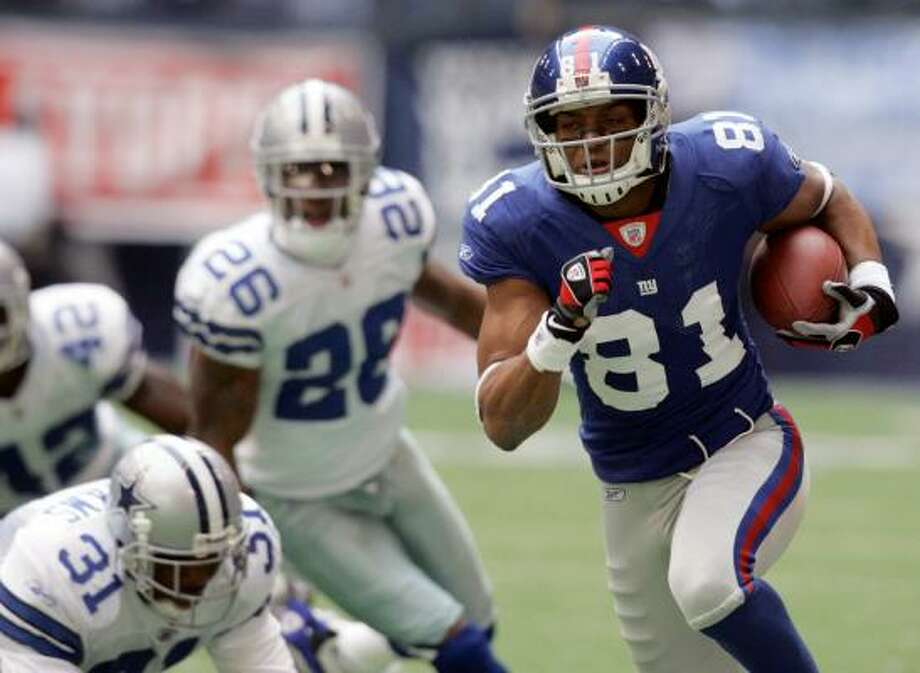 Amani Toomer (81) scored twice in the divisional round game. Photo: Tony Gutierrez, AP