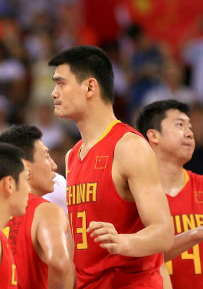 Yao Ming and team react to a 91-77 loss to Greece in the preliminary round at the Wukesong Indoor Stadium. Team China was 0-for-14 from behind the arc in the first half. Photo: Jamie Squire, Getty Images