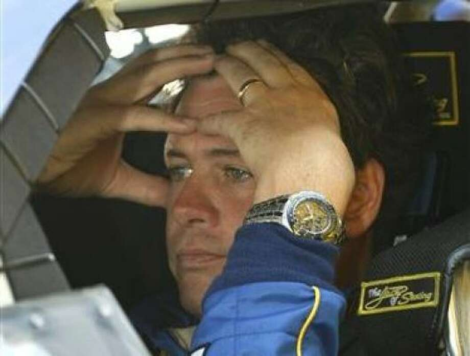 Michael Waltrip's crew chief and team director were thrown out of the Daytona 500 and suspended indefinitely. Photo: Glenn Smith, AP