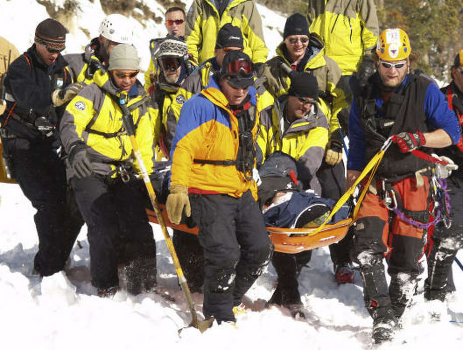 Rescue personnel bring up an avalanche survivor Saturday near Berthoud Pass, near Empire, Colo. Eight people were rescued from snow-buried vehicles after the huge avalanche knocked two cars off U.S. 40 near the pass. Photo: Michael Murphy, AP