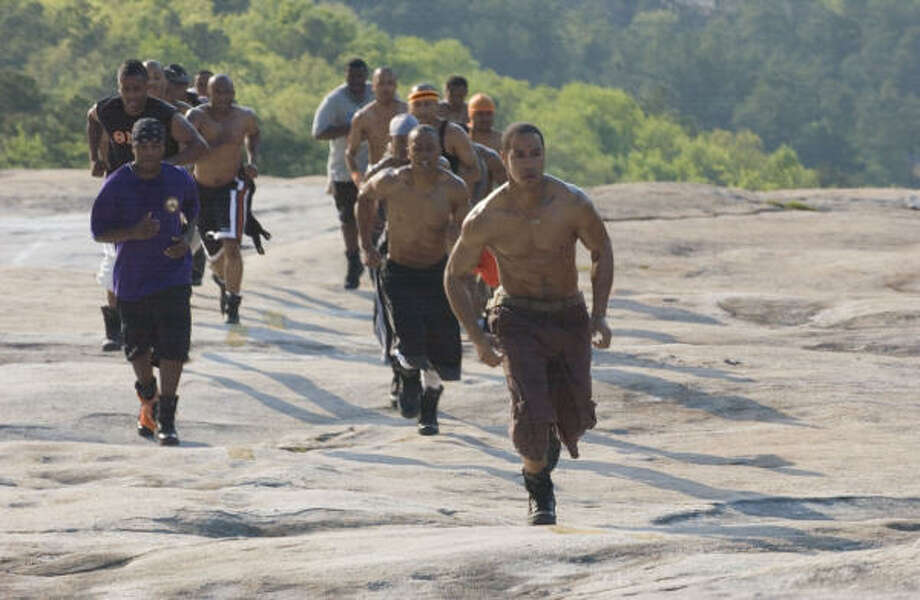 Rich (Ne-Yo, left), DJ (Columbus Short, center) and Sylvester (Brian J. White, right foreground) work out in Stomp the Yard. Photo: Alfeo Dixon, Sony Pictures Entertainment Inc.