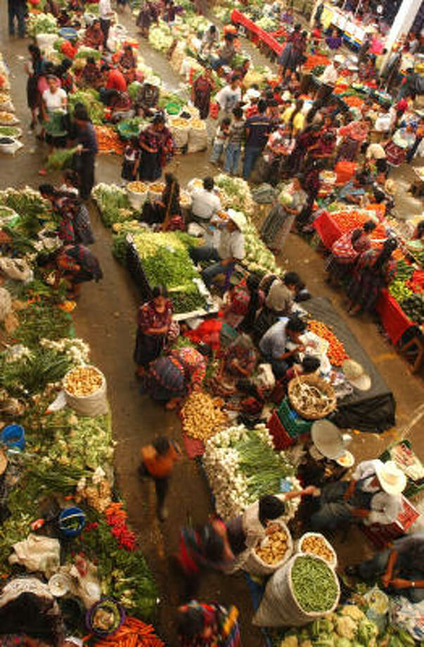 Villagers buy vegetables in Guatemala's Chichicastenango market. Photo: RODRIGO ABD, Associated Press