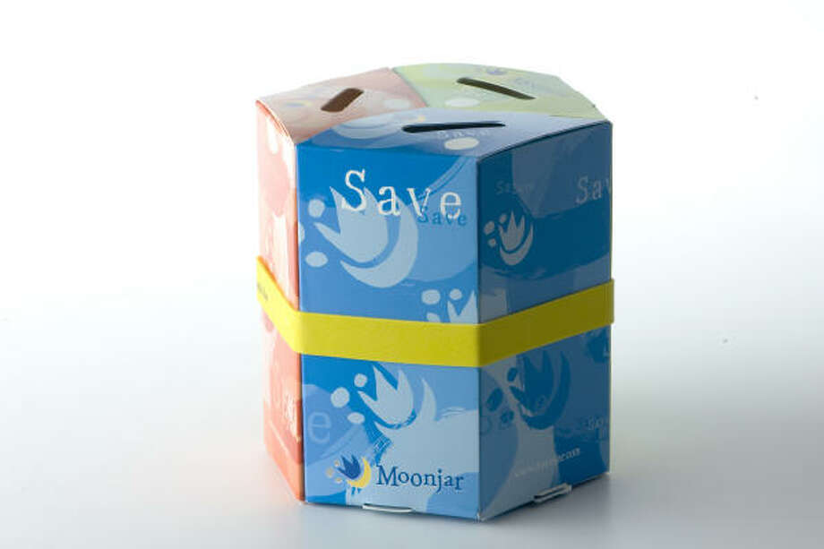 Moonjar Moneybox, which kids put together themselves, teaches them how to divide their savings up three ways: spending, saving and sharing. www.moonjar.com  Photo: Buster Dean, Chronicle
