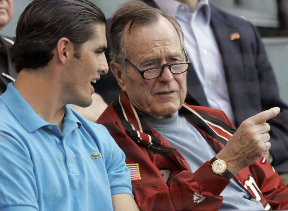 """David Carr (with former U.S. President George H. W. Bush at a recent Astros game) said the talent of the Panthers is """"something that I haven't been around."""" Photo: Pat Sullivan, AP"""