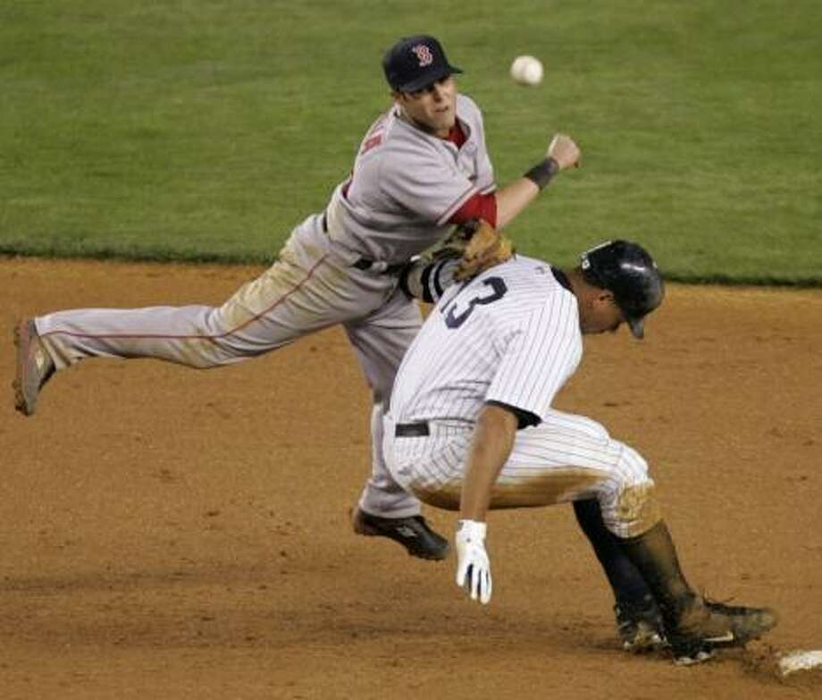 The Yankees' Alex Rodriguez prevents Red Sox second baseman Dustin Pedroia from turning a double play. Photo: JULIE JACOBSON, ASSOCIATED PRESS