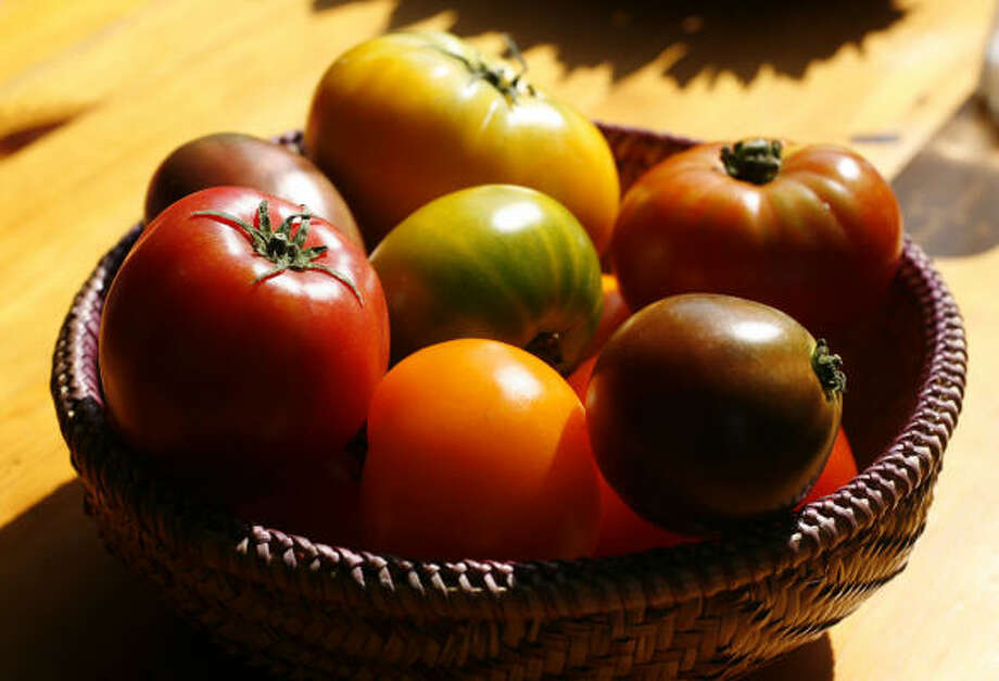 There's no mistaking the unbelievable taste of an heirloom tomato - a treasure passed down from generation to generation. We found these at Central Market. Photo: Karen Warren, Houston Chronicle