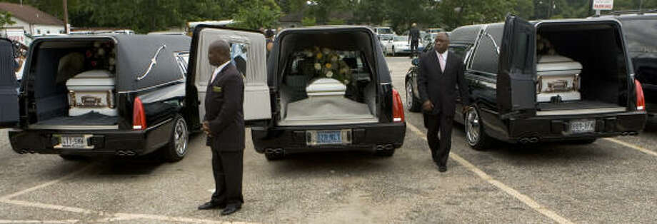 The caskets carrying the bodies of Tanika Gale Smith, Mickey Milik Stewart and Falicia Monique Charles sit in a trio of hearses after funeral services Saturday at New Mount Calvary Missionary Baptist Church Saturday.The three  were killed last Sunday in a car crash on the Eastex Freeway when Smith's car was hit head-on. Photo: Brett Coomer, Chronicle