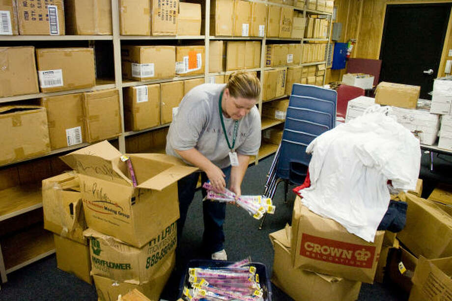 Joy Bradfield of AISD works to get the Alief Education Foundation's Uniform Effort clothing store organized and stocked before opening day Aug. 21. The store will provide free uniforms and supplies to disadvantaged students. Photo: R. Clayton McKee, For The Chronicle