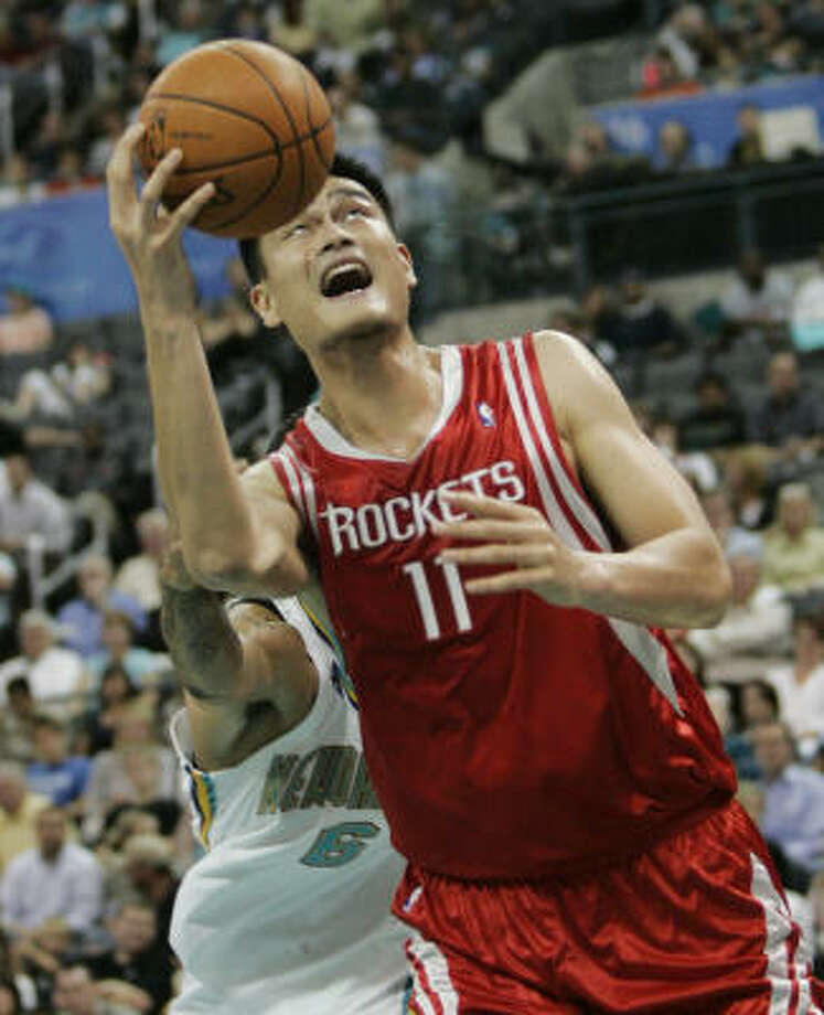 Rockets center Yao Ming finished with 13 points in less than 18 minutes for the Rockets, who squandered an early lead against the Hornets. Photo: Sue Ogrocki, AP