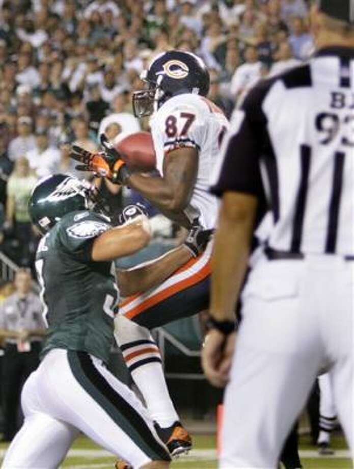 Muhsin Muhammad makes a catch for the Bears against the Eagles. He finished with five receptions for 79 yards. Photo: Rusty Kennedy, AP