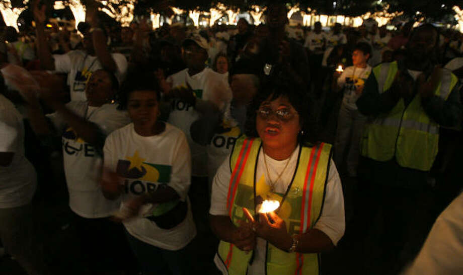 Sharon Rivers, a 26-year employee with the city of Houston, holds a candle along with fellow workers during a Thursday evening rally. Photo: James Nielsen, Chronicle