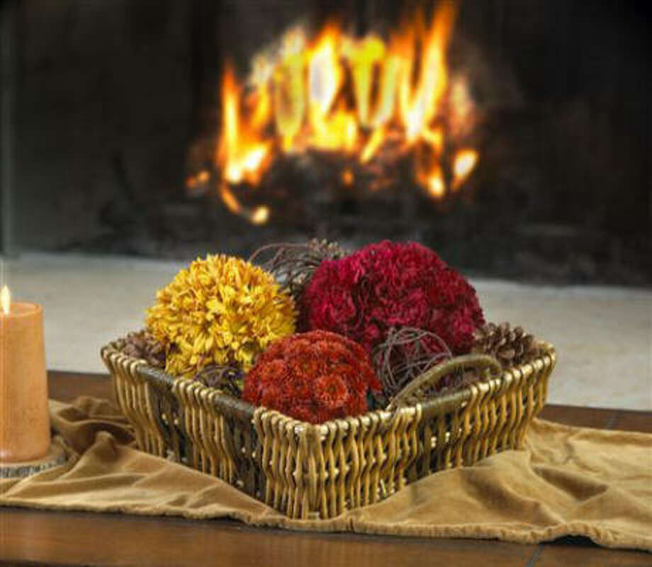Mum and carnation spheres in a basket Photo: Oasis Floral Products