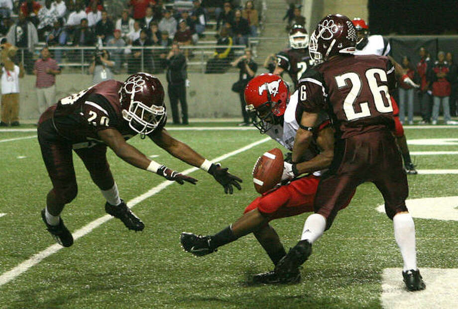 Cy-Fair was faulted for pass interference on this attempt to North Shore's Excelle Osborne. Osborne had two catches, both for scores. Photo: Steve Campbell, Chronicle