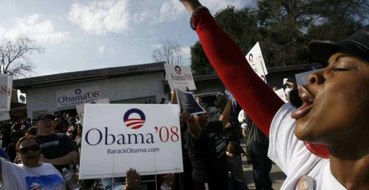 Roslyn Shorter rallies hundreds of Obama supporters at the new Houston office on Saturday.