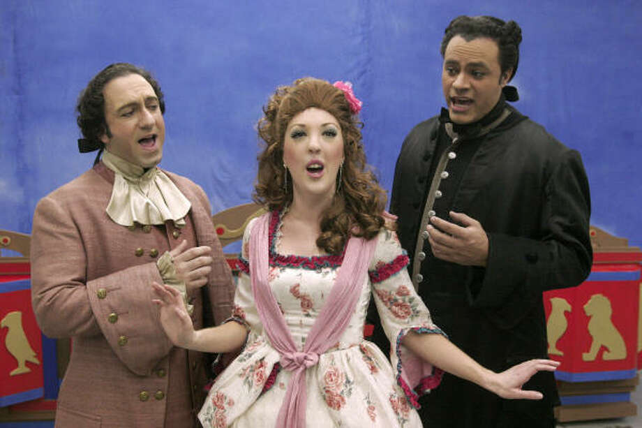 Luther Chakurian, left, Kristina Sullivan and Ilich Guardiola are the leads in Masquerade Theater's presentation of The Scarlet Pimpernel. Photo: Bill Olive, For The Chronicle