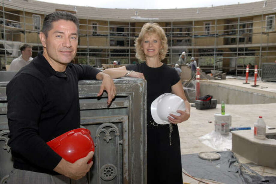 Kleibert Estrada, left, director of catering and special events, and Arlene O'Malley, director of sales and marketing, pose in front of the six new ``Super Villa'' suites overlooking the second-floor pool area at Hotel ZaZa. Photo: Kim Christensen, For The Chronicle