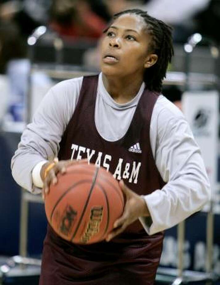 A&M guard A'Quonesia Franklin prepares to take a shot during an NCAA women's basketball tournament practice session Saturday. Photo: Danny Johnston, AP