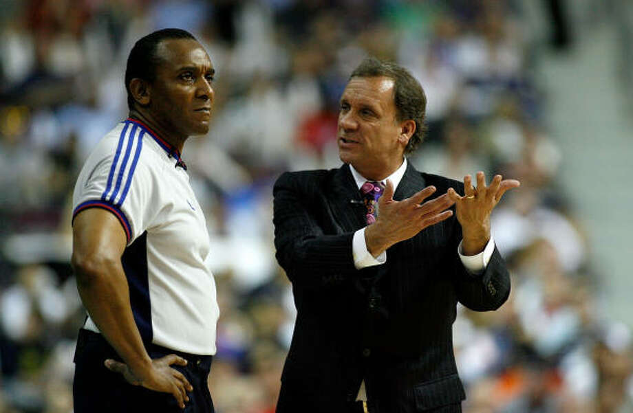 Flip Saunders (with ref Eddie F. Rush) lost in three consecutive Eastern Conference finals series. Photo: Gregory Shamus, Getty Images
