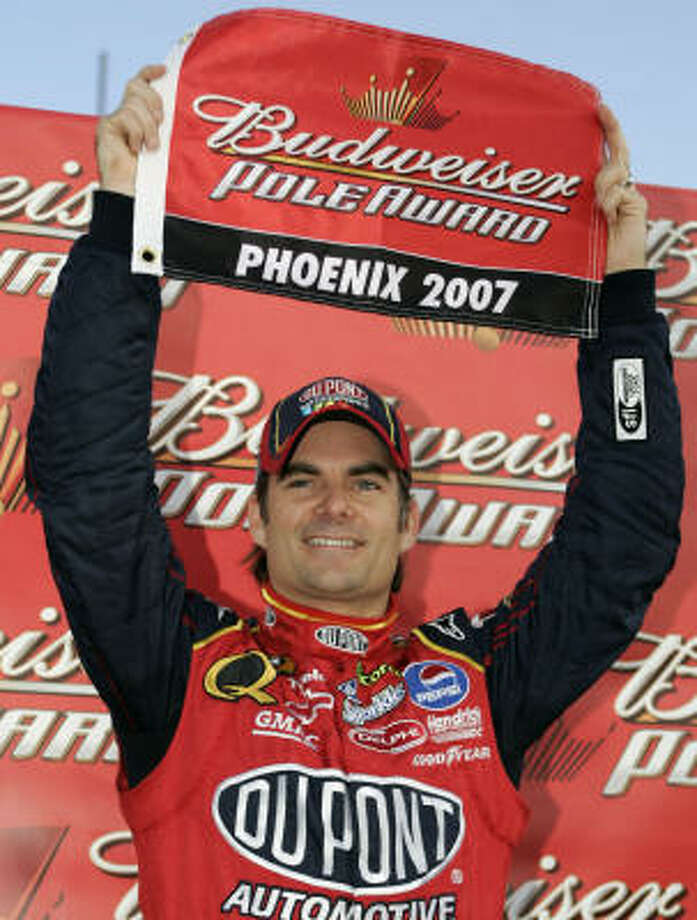 Jeff Gordon holds up the pole-award flag -- his fourth of the season -- after leading the qualifying for Saturday's Subway Fresh Fit 500 at Phoenix International Raceway Photo: Todd Warshaw, Getty Images