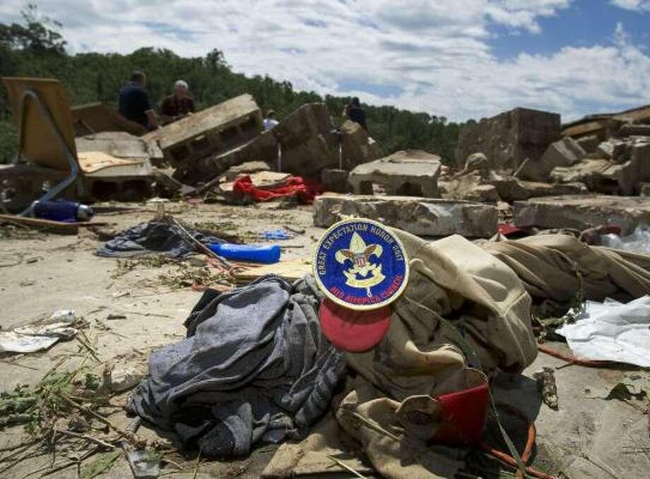 A Boy Scout uniform lies in the rubble left by a tornado that struck a Boy Scout ranch in Iowa on Wednesday. Four boys were killed. Photo: MATT MILLER, ASSOCIATED PRESS