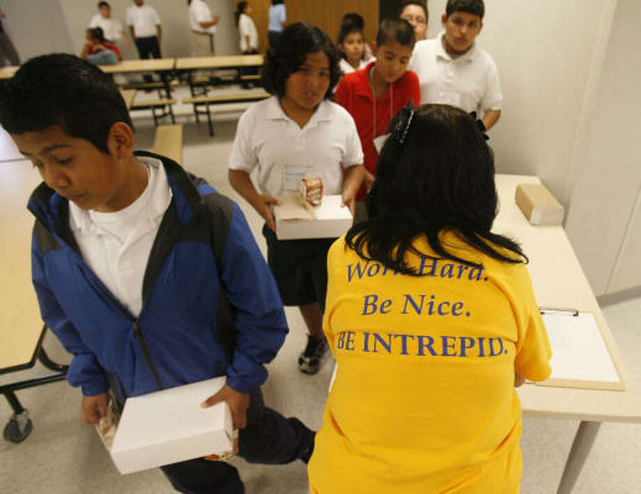 "Office manager Sylvia Mendez checks in students during lunch Monday at KIPP Intrepid. Principal Carie-Anne Simmons told the students they're ""part of something bigger than themselves."" Photo: Karen Warren, Chronicle"