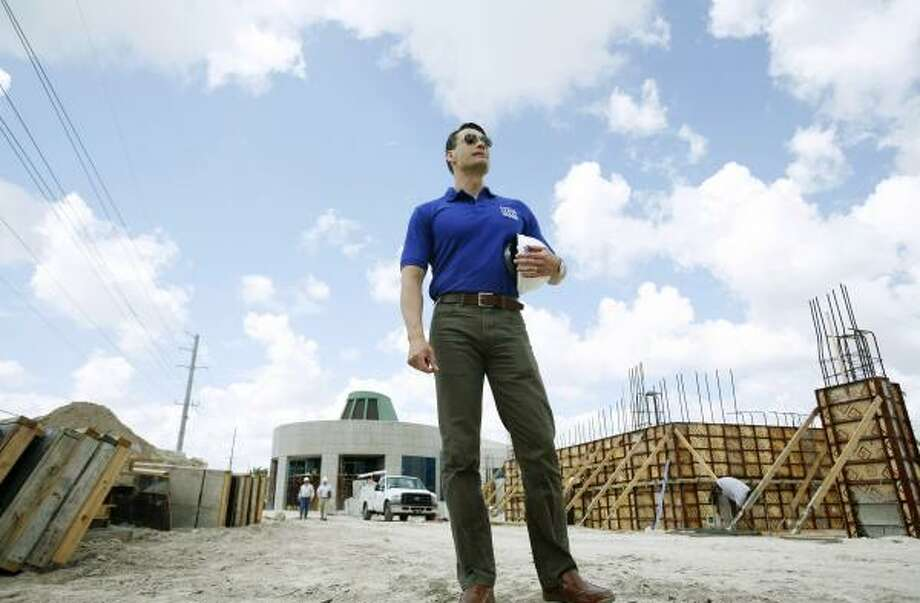 Rodolfo Acevedo, an architect who became a U.S. citizen last summer, is designing five new offices for U.S. Citizenship and Immigration Services, making them appealing to prospective citizens. Photo: J. PAT CARTER, ASSOCIATED PRESS