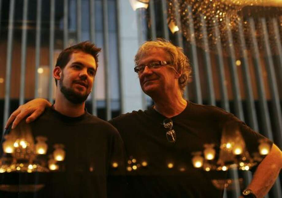 """David Gilmour, right, documented his experiment with his son Jesse in The Film Club.""""We'd have conversations that sprang out of these films,"""" Jesse says. """"I did learn from that, things guys need to talk about, heartbreak and drugs and all that."""" Photo: ED OU, ASSOCIATED PRESS"""