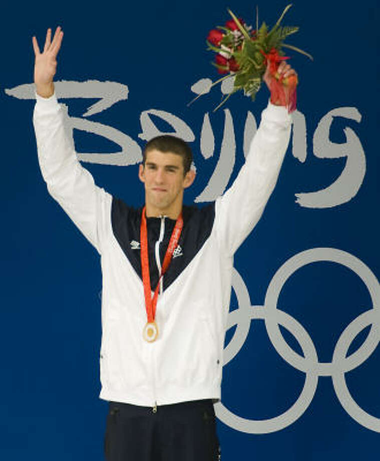 Michael Phelps acquired enough gold to affect the commodities market, winning eight times and setting numerous records, individual and relay. Photo: Smiley N. Pool, Houston Chronicle