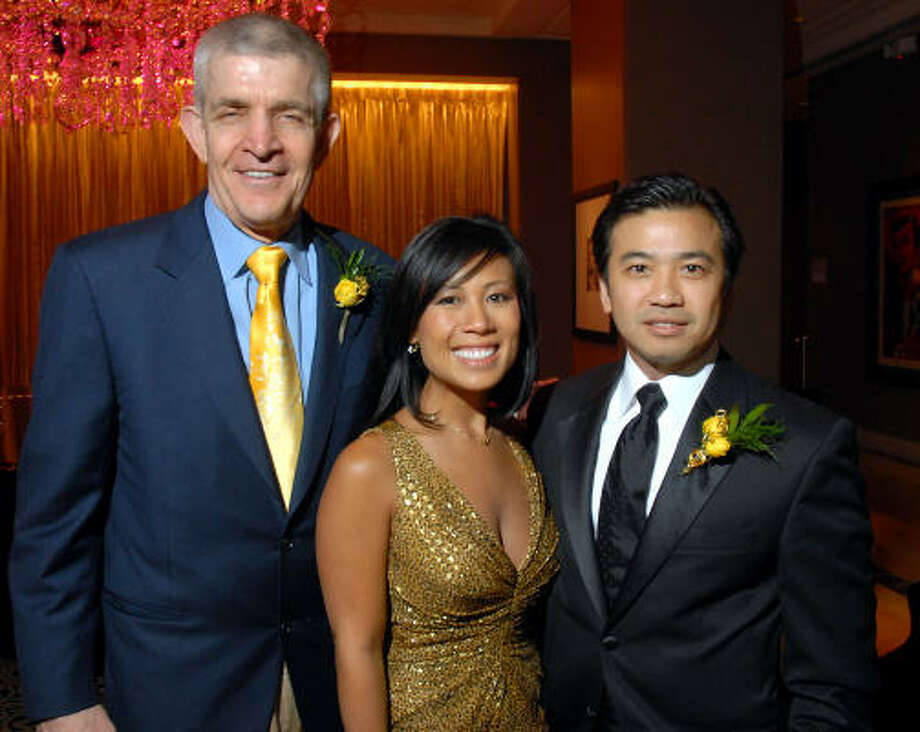 Honorary chair Jim McIngvale, from left, joined Asian American Family Services gala chairs Chau Nguyen and Viet Hoang at Hotel ZaZa for the benefit. Photo: Dave Rossman, For The Chronicle