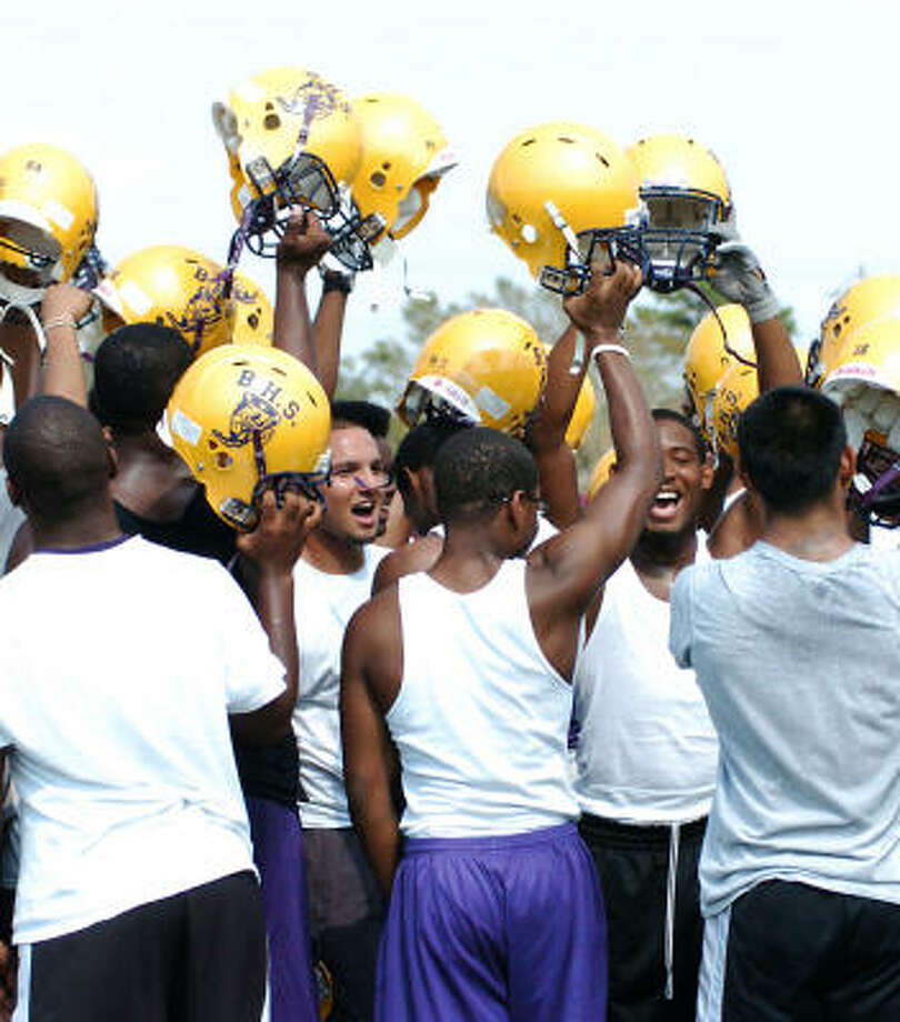Spirits are high as the Galveston Ball Tornadoes prepare to resume practices at La Marque High School in the wake of Hurricane Ike. Photo: Kirk Sides