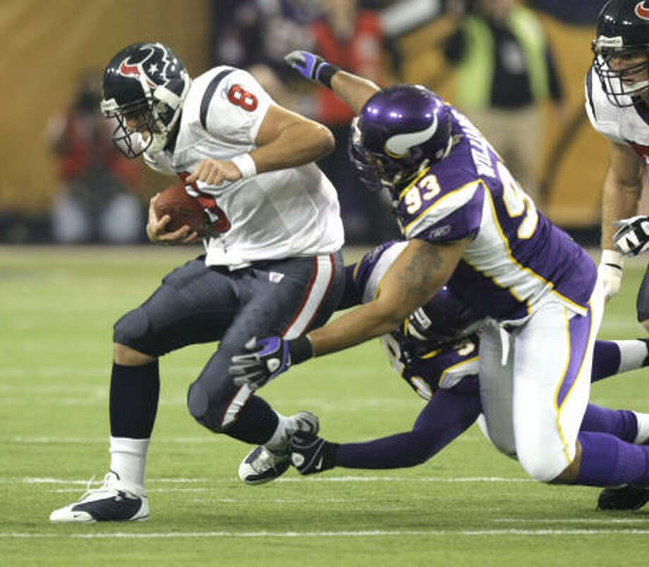 Texans quarterback Matt Schaub (8) is sacked by Vikings defensive end Ray Edwards (91) and defensive tackle Kevin Williams (93) during the first quarter. Photo: Brett Coomer, Chronicle