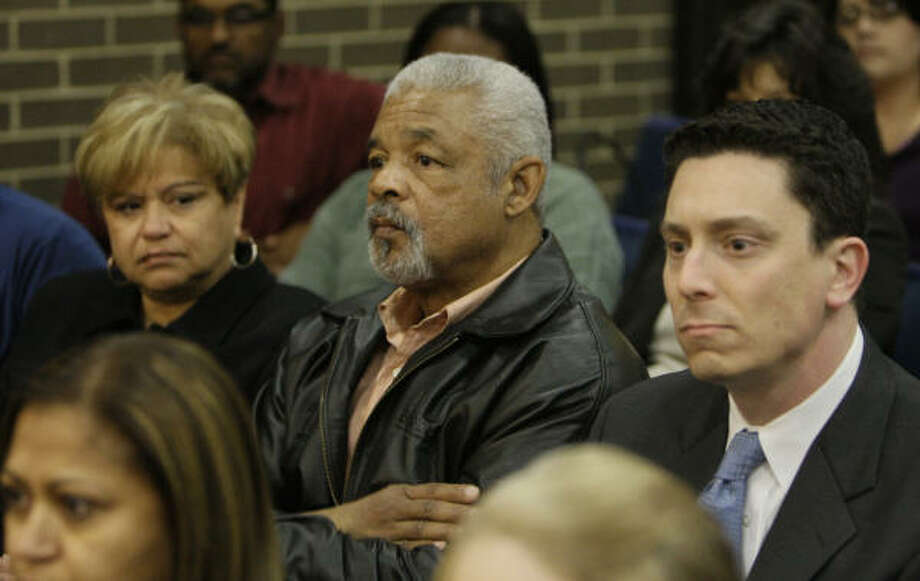 Marian Tolan, left, her husband, Bobby Tolan, center, and their attorney, Geoffrey Berg, attend the Bellaire City Council meeting Monday. Photo: Melissa Phillip, Chronicle