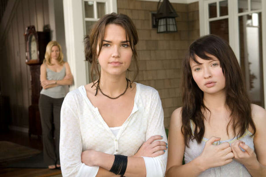 Rachel (Elizabeth Banks), from left, arouses the suspicions of sisters Alex (Arielle Kebbel) and Anna (Emily Browning) when she becomes engaged to their father in The Uninvited. Photo: Kimberley French, Lionsgate Films
