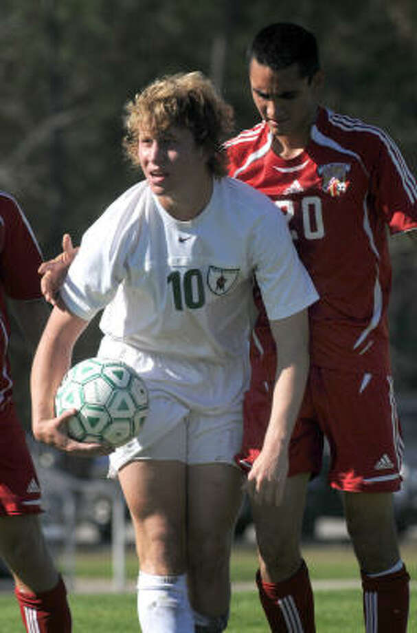The Woodlands midfielder Connor Mowery scored the game winning goal in the first half of the Highlanders game against district rival College Park on Tuesday. Photo: Jerry Baker, For The Chronicle