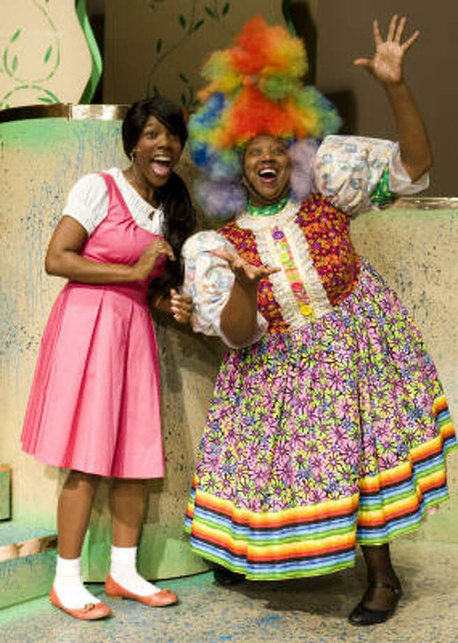 Melanie Finley, left, plays Dorothy and Tracey E. Wheat stars as Addapearle in the Ensemble Theatre's new production of The Wiz, which runs through July 26. Photo: Brett Coomer :, Chronicle